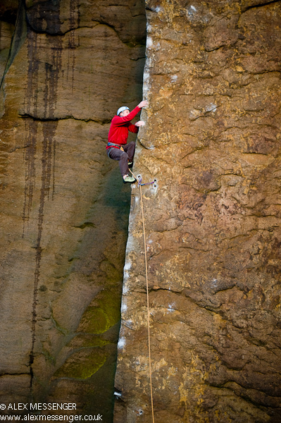 Pete Whittaker climbing up the other side of the inspirational Master's Edge at Millstone, England, Alex Messenger