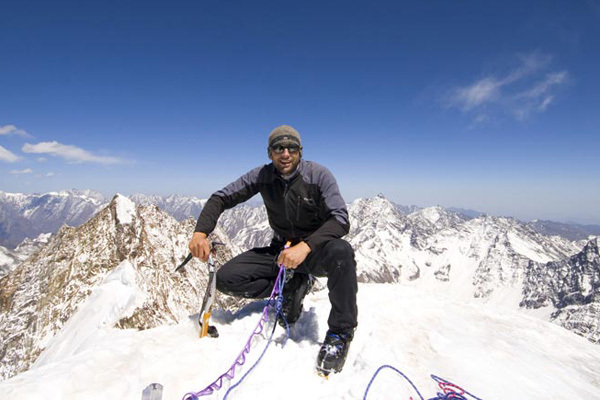 Joseph Puryear on the summit of Lara Shan - Qionglai Mountains, China, Chad Kellogg
