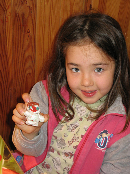 Zalia Rakhmetov with a snowman she built on her own, Anna Piunova