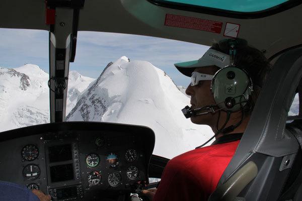 Simone Moro flying a helicopter, arch. Simone Moro