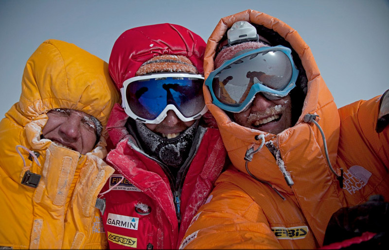 Simone Moro, Cory Richards and Denis Urubko on the summit of Gasherbrum II after the historic first winter ascent., Cory Richards