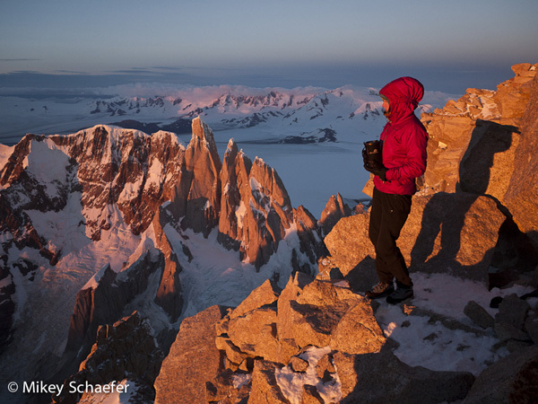 Kate Rutherford enjoying the spectacular view from the summit of Fitz Roy onto Cerro Torre, February 2011, Mikey Schaefer
