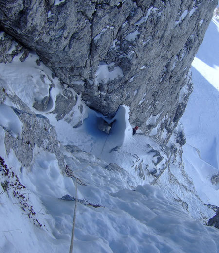 Climbing up towards the belay on the 5th pitch of Cugi's Corner, NW Face Cimon di Palantina, Dolomites, arch. Bona - Favero