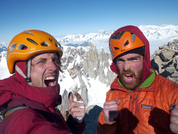 Nicolas Favresse and Sean Villanueva on the summit of Fitz Roy (Patagonia) after having climbed the East Face. Cerro Torre can be seen in the background., Favresse & Villanueva