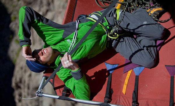 Hansjörg Auer resting on the portaledge, Cory Richards