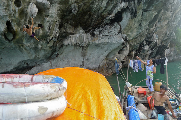 Climbing above a bemused Vietnamese boat family, achive Steve & Angie Bradshaw