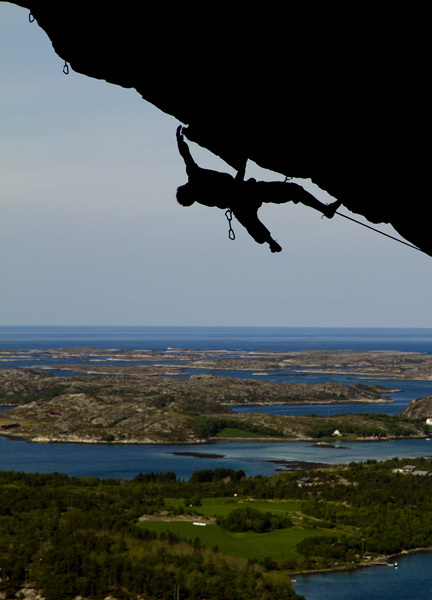 Magnus Midtbö climbing high above the fjords at Flatanger in Norway., Kieran Kolle