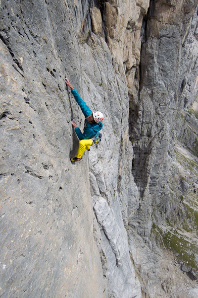 Hansjörg Auer making the first ascent of his route Bruberliebe (800m/8b/8b+), Marmolada, Dolomites. Damiano Levati