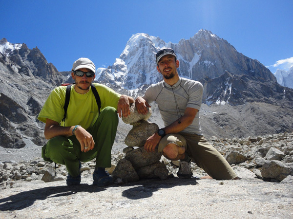 Nejc Marčič and Luka Stražar and, in the background, the K7 West (6934m) Charakusa valley, (Karakoram, Himalaya).