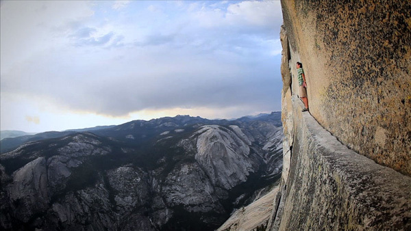 Alex Honnold on the Thank God Ledge, high up on the Regular Northwest Face route on Half Dome, Yosemite, www.senderfilms.com