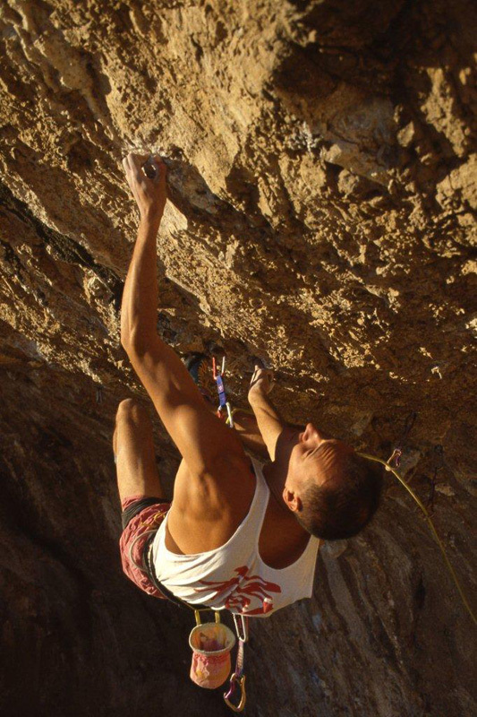 Alessandro Jolly Lamberti making the first ascent of Il Corvo 8c, 1994, Alfredo Smargiassi