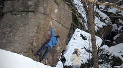 Stella Plantin and Hanne Riise on the boulder problem Sockerbiten at Utby in Sweden