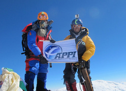 Sano Babu Sunuwar and Lakpa Tsheri Sherpa arrived at the summit of Mount Everest (29,035 feet) on May 21, 2011. This was Lapka's fourth summit and Babu's first. They proudly hold a banner from Babu's workplace, the Association of Paragliding Pilots and Instructors.