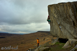 Michele Caminati climbing the boulder problem Careless Torque 8A at Stanage.