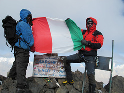 Ruwenzori: David Orlandi on the summit of Cima Margherita 5109m, the third highest mountain in Africa.