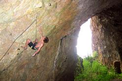Domen Škofic climbing Halupca 1979 (9a) at Ospo, Slovenia