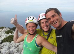 Caroline Ciavaldini, James Pearson and Pietro dal Prà celebrating on the top of Aria (8a+, 350m) Punta Plumare, Sardinia.