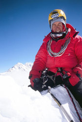 Valery on the summit of Jannu. Kangchengunga can be seen in the background.