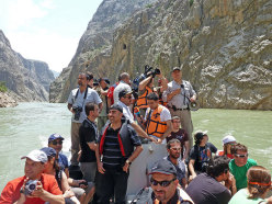Photographers and filmmakers on a boat on river Eufrate.