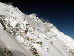The final (east) section of the Mazeno ridge and the summit of Nanga Parbat in the furthest distance.