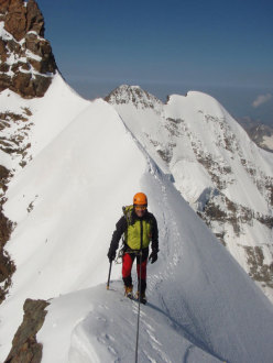 Alberto Magliano negotiating the knife-edge ridge along the Scerscen - Bernina traverse