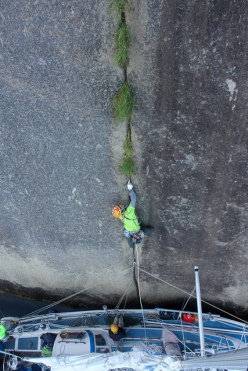 Steve Bradshaw fighting grass on pitch 1, Improbability Drive, Impossible Wall, Greenland