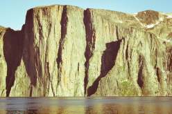 El Cap by the sea? The 850m Impossible wall bathed in midnight sun.