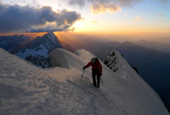 Luka Krajnc at dawn on the Peuterey ridge, Mont Blanc