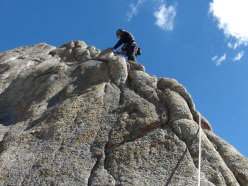 Nikolay Petkov climbing the last few meters to reach the summit of Grey Tower.
