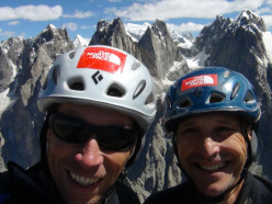 Doychin Boyanov and Nikolay Petkov on the summit of Grey Tower, clearly visible in the background the peaks Levski, Rila Tangra, Trident, Agil.