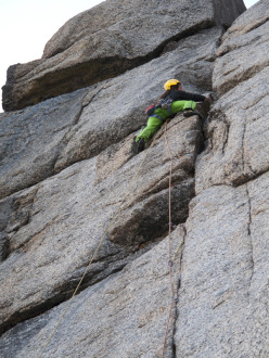 Greenland, Tasermiut Fjord: Tomas Brt on the crux pitch of Keep Panic, Please