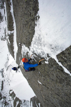 Jeff Mercier leading pitch 10 of Full Love... for dry and ice (V, 5+,M6 R, 500m): a super thin series of moves takes you to a full arm stretch to decent ice above and a sigh of relief