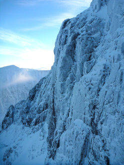 Sioux Wall on Ben Nevis, Scotland. Tomahawk Crack takes the cleaned line up the centre of the face.