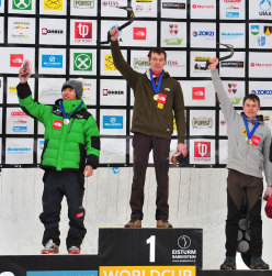 Men's podium at Rabenstein during the third stage of the Ice Climbing World Cup 2013. From left to right: Park Heeyong (KOR), Maxim Tomilov (RUS), Alexey Tomilov (RUS).