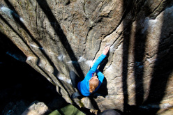 Katharina Saurwein climbing the boulder problem Fake Pamplemousse 8A, Ticino, Switzerland.