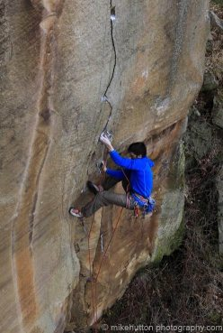 Tom Randall making the first ascent of Soft Parade E6 6b, Hallmoor Quarry, Peak District, England