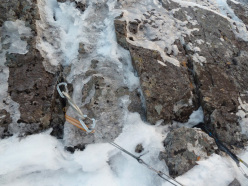 Belaying on a torque nut and two ice cliffs.