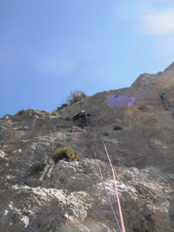 Adriano Cavallaro climbing the last pitch above the belay of Via Mediterraneo