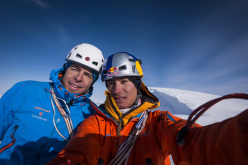 Dani Arnold and David Lama on the summit of their route Bird of Prey on Moose's Tooth, Alaska.