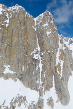 The obvious line of Ham and Eggs up the south Face of Mooses Tooth in Alaska, first climbed in 1975 by Thomas Davies, John Krakauer and Nate Zinsser.