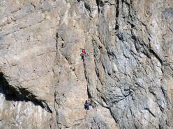 La via Del Risveglio (240 m, 6b max, 5c obbl.) aperta da Gian Carlo Grassi, Danilo Galante e Roberto Bonelli il 5 Maggio del 1974 sulla Parete Rossa di Catteissard, in Valle di Susa.