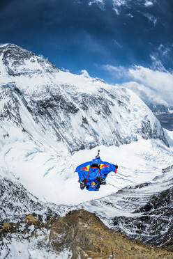 05/05/2013: Russian BASE jumper Valery Rozov leaps from a record 7720m off the North Face of Everest.