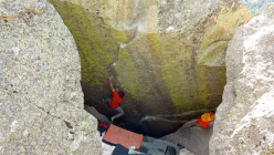 Ethan Pringle on the boulder problem Sunseeker 8B at Mt. Evans, Colorado, USA.