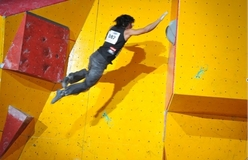 David Lama leaping to victory during the second stage of the Bouldering World Cup 2008 on the Reunion Island.