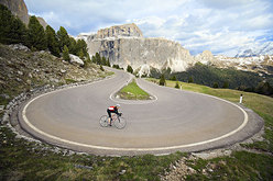 Amy Rasic riding through the steep, hairpin turns of the Sella Pass above Canazei, Italy