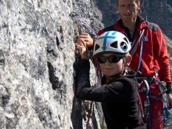 Paolo Sterni having completed the belay on Gallo George, Muraglia del Giau, Lastoni di Formin, Dolomites