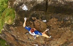 Sonnie Trotter on the final moves of Rhapsody, Dumbarton Rock. Scotland.