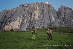 Rolando Larcher and Geremia Vergoni reaching the base of Invisibilis, South Face Marmolada d'Ombretta (Dolomites)