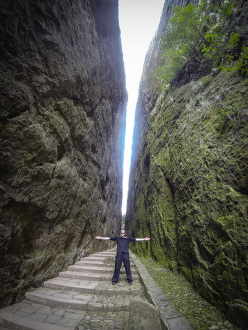 Jeb Corliss and the crack on Mount Jianglang in China.