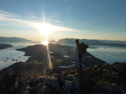 Peter Hill descending the ridge of Umanatsiaq Mountain in the midnight sun after the first ascent of 'Flake or Death'